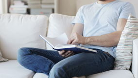 Close up of man reading book at home stock video footage