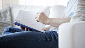 Close up of man reading book at home stock footage