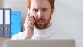 Close-up of  Man with Red Hairs Talking on Phone, Discussing. High quality Royalty Free Stock Images