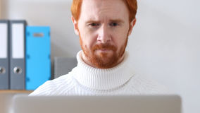 Close-up of  Man with Red Hairs Thinking about Work Royalty Free Stock Photography