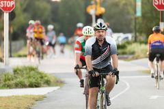 Close up of man riding his bike with other bikers in background bike, editorial. stock image