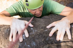 Close up man rock climbing Stock Photos