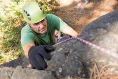 Close up man rock climbing Stock Images