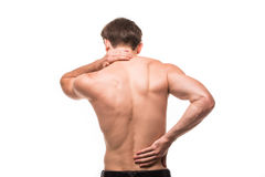 Close up of man rubbing his painful back on white background. Close up of man rubbing his painful back. Pain relief, chiropractic concept Royalty Free Stock Images