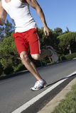 Close Up Of Man Running On Road Stock Photo