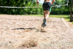 Close-up Of A Man Running Through Soil Royalty Free Stock Photography