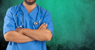 Close up of a man's arms crossed of medical staff. On green white background Royalty Free Stock Photos
