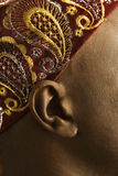 Close-up of man's ear and African hat. Close-up side view of African-American mid-adult man wearing traditional African hat Stock Photo