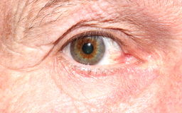 Close up of man's eye. Looking at camera, showing expression and detail of eyeball and wrinkled skin Stock Photo