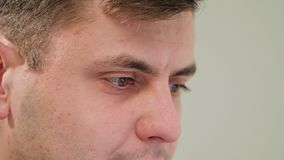 Close-up of a man`s face indoors stock footage