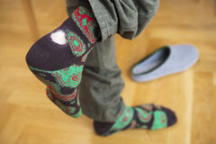 Close-up of man's feet wearing socks with hole Royalty Free Stock Photo