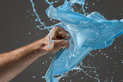 Close-up of a man's fist punching through liquid Royalty Free Stock Images