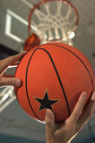 Close-up of a man`s hand holding a basketball Royalty Free Stock Photo