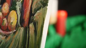Close up of man`s hand painting still life picture on canvas in art studio.  stock footage