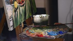 Close up of man`s hand painting still life picture on canvas in art studio.  stock video