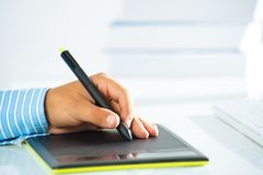 Close-up of a man's hand with a pen stylus Stock Photos