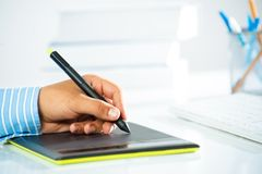 Close-up of a man's hand with a pen stylus Royalty Free Stock Photos