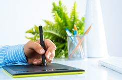 Close-up of a man's hand with a pen stylus Stock Images