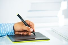 Close-up of a man's hand with a pen stylus Stock Image