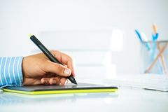 Close-up of a man's hand with a pen stylus Royalty Free Stock Photo
