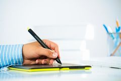 Close-up of a man's hand with a pen stylus Royalty Free Stock Image