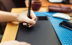 Close-up of a man's hand with a pen stylus Royalty Free Stock Images