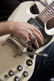 Close-up of man's hand playing electric guitar Royalty Free Stock Photos