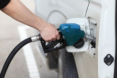 Close-up of a man's hand refilling a car with a petrol/gasoline Royalty Free Stock Photos