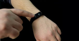 Close up of man`s hand with a smart watch with the pulse rate. stock video footage