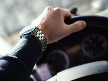 Close-Up Of Man's Hand On Steering Wheel Stock Photo