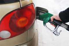 Close-up of a man's hand using a petrol pump Stock Image