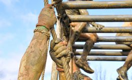 Close-up of man's hands climbing the rope Stock Photo
