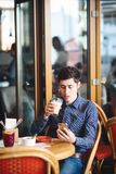 Man with coffee and smartphone stock photography