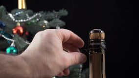 Close up of man`s hands opening a bottle of champagne. stock video