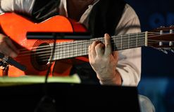 Close-up of a man`s hands playing the classical guitar.  stock photos