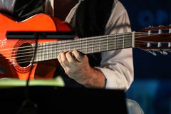 Close-up of a man`s hands playing the classical guitar. Close-up of a man`s hands playing the classical guitar royalty free stock photo