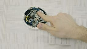 Close-up man`s hands repairing the wires on electrical junction box with screwdriver. Open the lid.  stock video footage