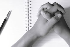 Close up of man`s hands in spiral notepad. Black and white tone Stock Photo