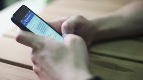 Close up of man`s hands use smartphone texting in messenger social media.  stock footage