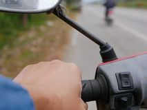 A man`s left hand holding on a motorbike handlebar stock photography