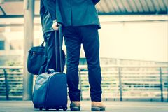 Close up of man`s legs with leather shoes and document bag while. He is  standing and waiting in the city. Business Trip concept Stock Images
