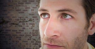 Close up of man`s sad face against brown brick wall stock photos