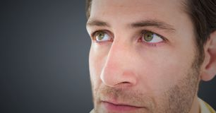 Close up of man`s sad face against grey background stock images