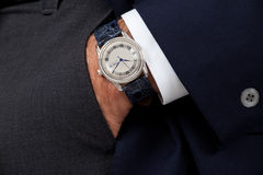 Close up of a man's watch. Close up of a man's hand wearing a watch Stock Photos