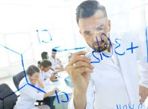 Close up of a Man scientist working with formulas. In the laboratory Royalty Free Stock Image