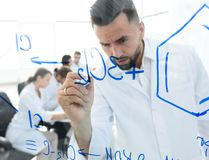 Close up of a Man scientist working with formulas. In the laboratory Stock Images