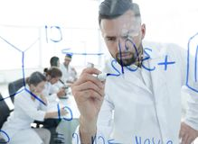 Close up of a Man scientist working with formulas. In the laboratory Royalty Free Stock Photography