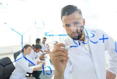 Close up of a Man scientist working with formulas. In the laboratory Royalty Free Stock Images