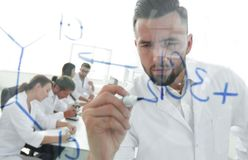 Close up of a Man scientist working with formulas. In the laboratory Royalty Free Stock Photos