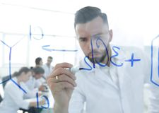 Close up of a Man scientist working with formulas Stock Photos